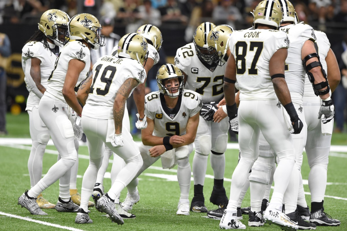 Jan 5, 2020; New Orleans, Louisiana, USA; New Orleans Saints quarterback Drew Brees (9) calls a play in the huddle during the first quarter of a NFC Wild Card playoff football game against the Minnesota Vikings at the Mercedes-Benz Superdome. Mandatory Credit: John David Mercer-USA TODAY