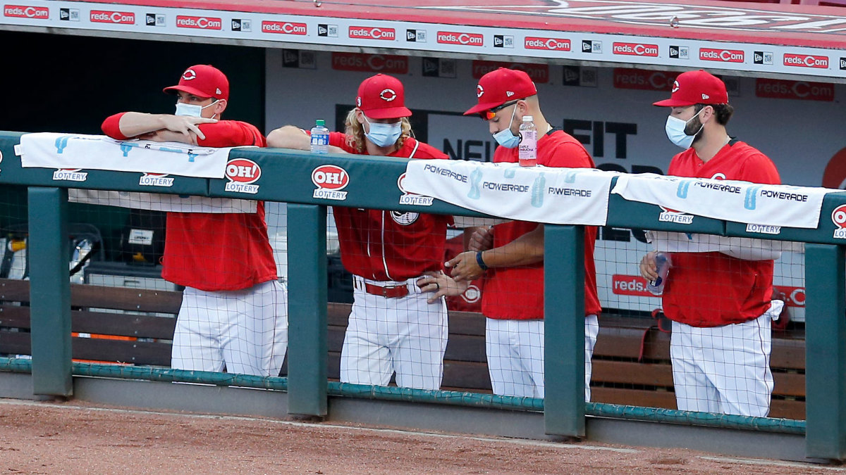 Reds players wearing masks in the dugout