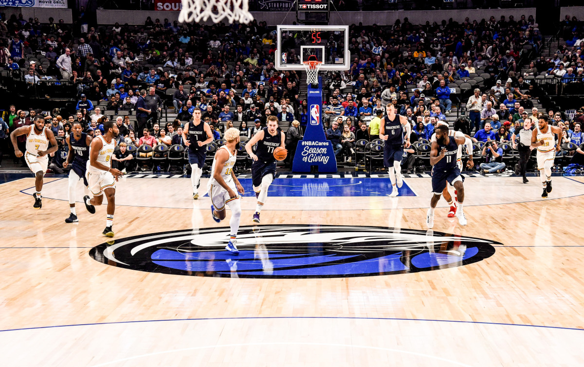 "The Mavericks' website says Ronzone had ""his fingerprints all over"" the scouting of the team's star, Luka Doncic."