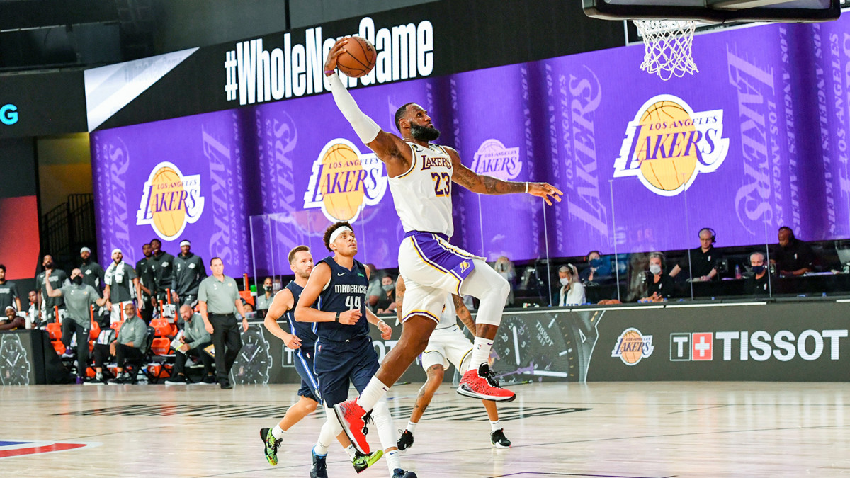 LeBron James of the Lakers dunks the ball