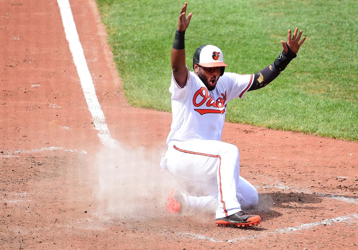 Baltimore Orioles second baseman Hanser Alberto (57) reacts after scoring a run