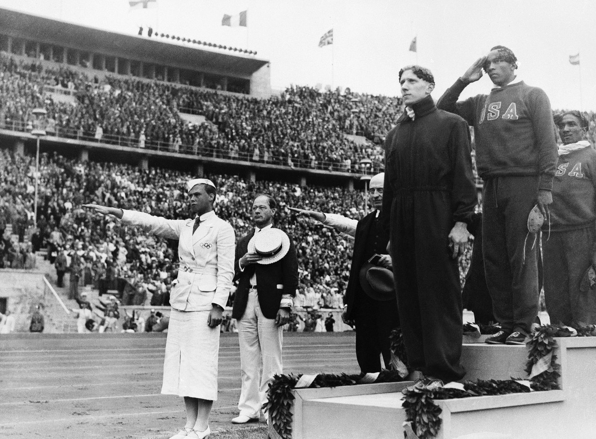 Owens (top) took gold in the 100-meter final in Berlin, in 1936, overshadowing for a moment what amounted to a Nazi rally.