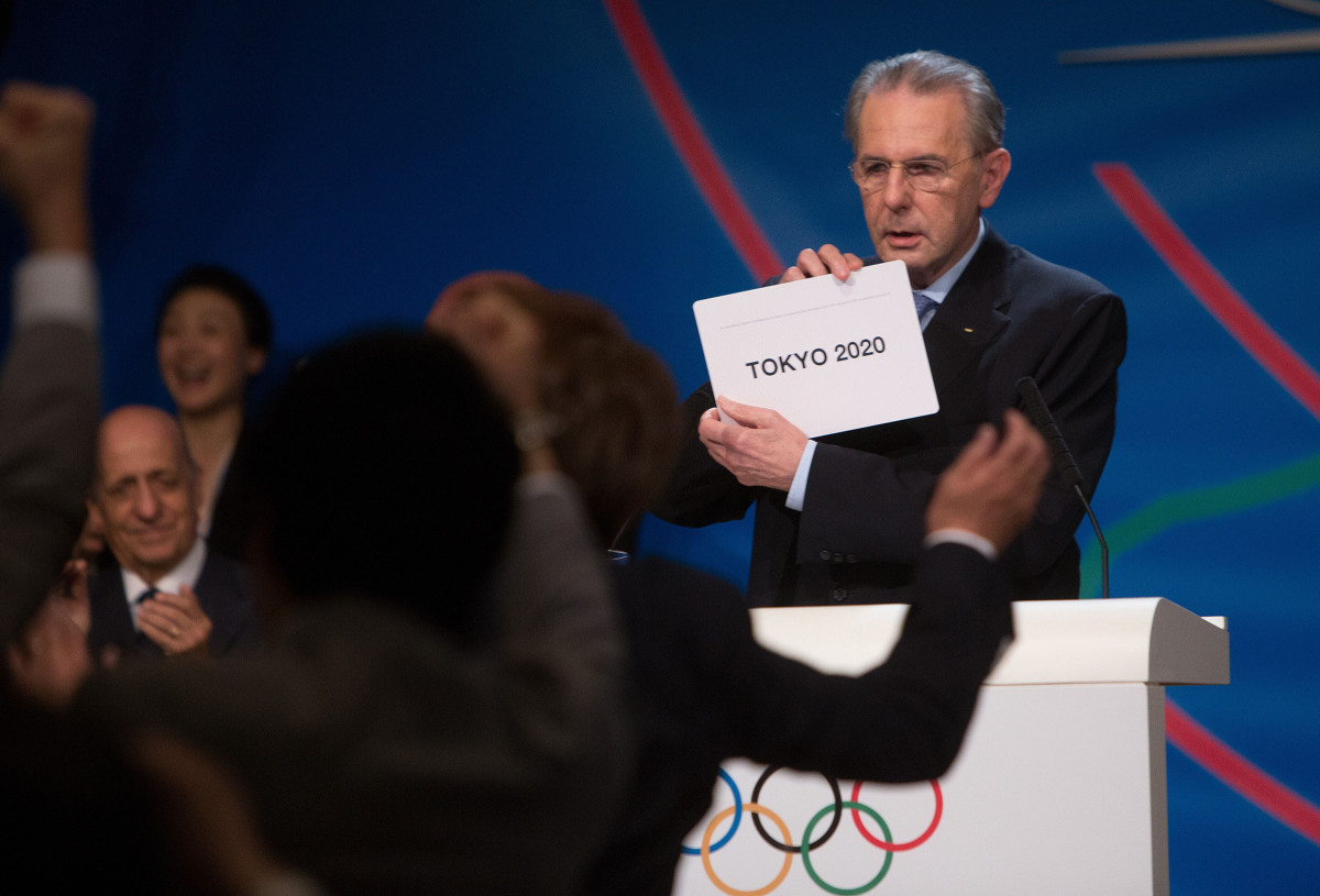 Jacques Rogge, then the IOC president, unveiled the Tokyo win in 2013.