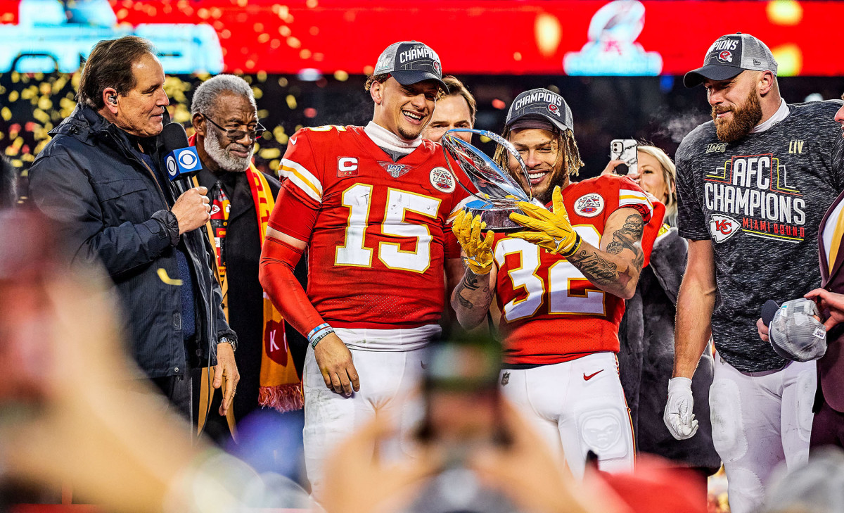 Chiefs stars Patrick Mahomes, Tyrann Mathieu and Travis Kelce celebrating with the Lamar Hunt Trophy after defeating the Titans in the AFC championship game