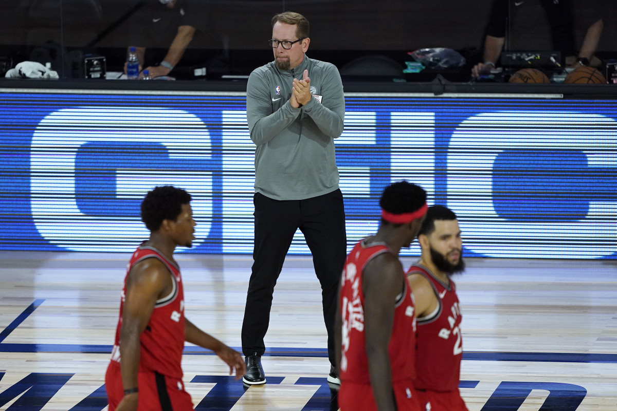 Toronto Raptors' head coach Nick Nurse claps for his players during the second half of an NBA basketball game against the Miami Heat at the HP Field House.