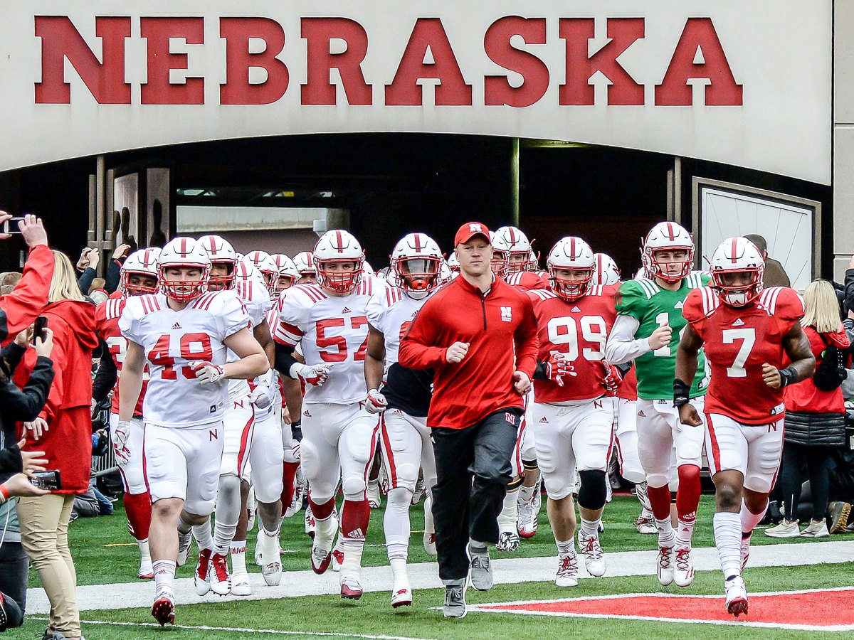 Nebraska football and coach Scott Frost run out of the tunnel