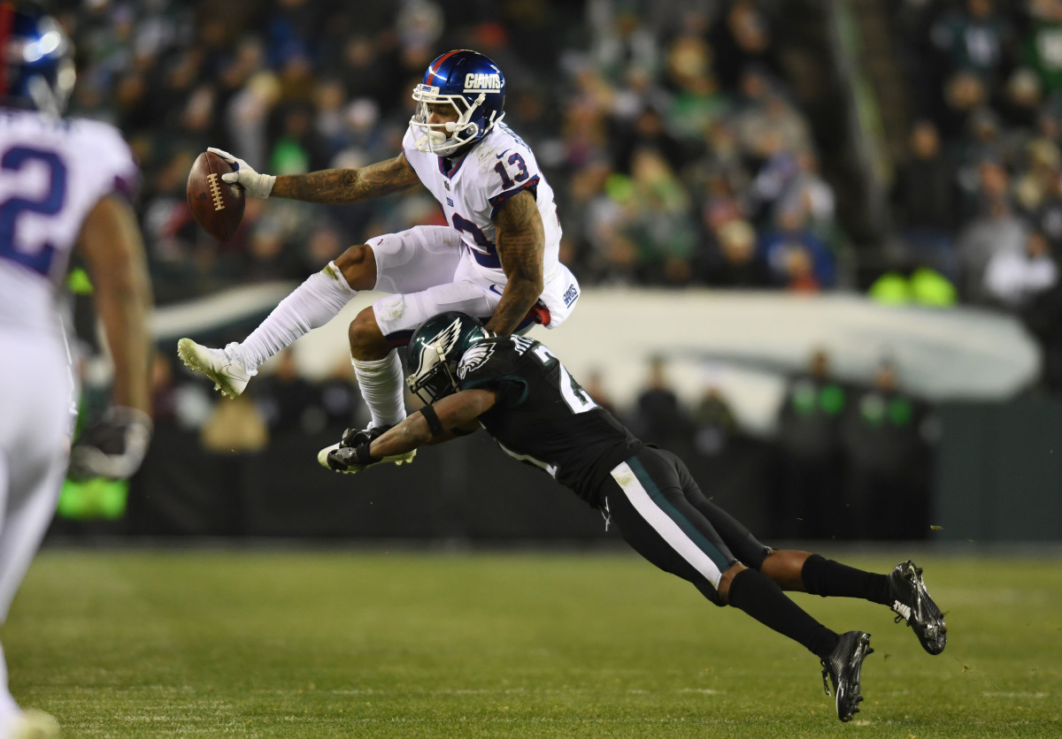 Odell Beckham Jr. leaps in an attempt to evade a tackle by the Eagles, Dec. 22, 2016.