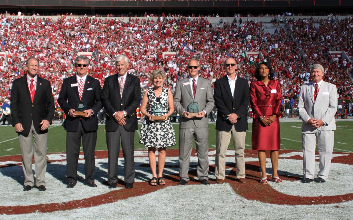 Davis accepts the Paul W. Bryant Alumni-Athlete Award on behalf of Croom in 2015