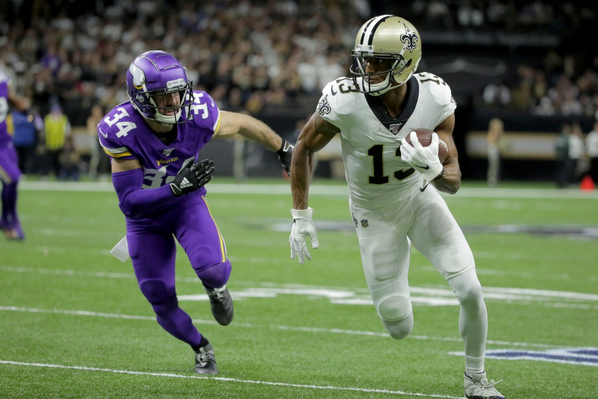 Jan 5, 2020; New Orleans, Louisiana, USA; New Orleans Saints wide receiver Michael Thomas (13) runs after a pass reception against Minnesota Vikings strong safety Andrew Sendejo (34) during the first quarter of a NFC Wild Card playoff football game at the Mercedes-Benz Superdome. Mandatory Credit: Derick Hingle-USA TODAY