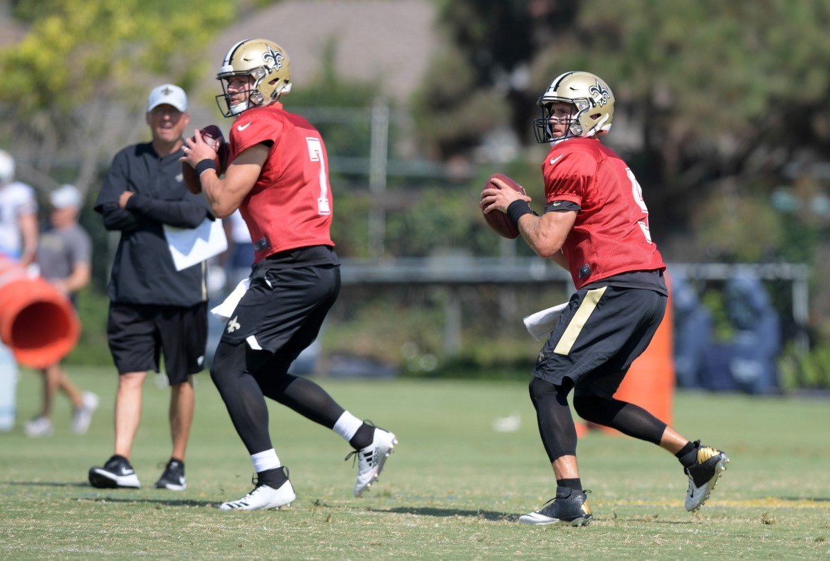 Aug 23, 2018; Costa Mesa, CA, USA: New Orleans Saints quarterback Taysom Hill (7) and quarterback Drew Brees (9) throw the ball as offensive coordinator Pete Carmichael (left) watches during joint practice against the Los Angeles Chargerat the Jack. R. Hammett Sports Complex. Mandatory Credit: Kirby Lee-USA TODAY Sports