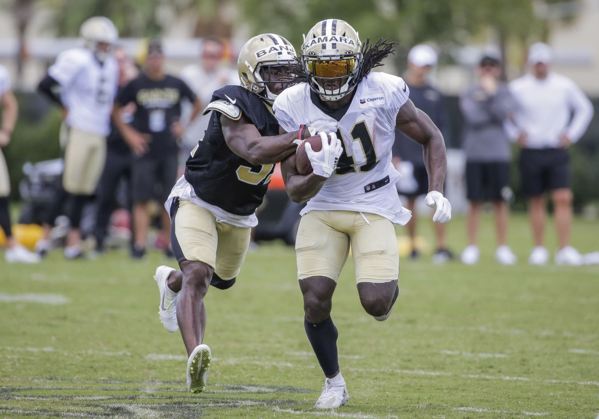 Jul 28, 2019; Metairie, LA, USA; New Orleans Saints running back Alvin Kamara (41) pulls away from defensive back Chris Banjo (31) during training camp at the Ochsner Sports Performance Center. Mandatory Credit: Derick E. Hingle-USA TODAY Sports
