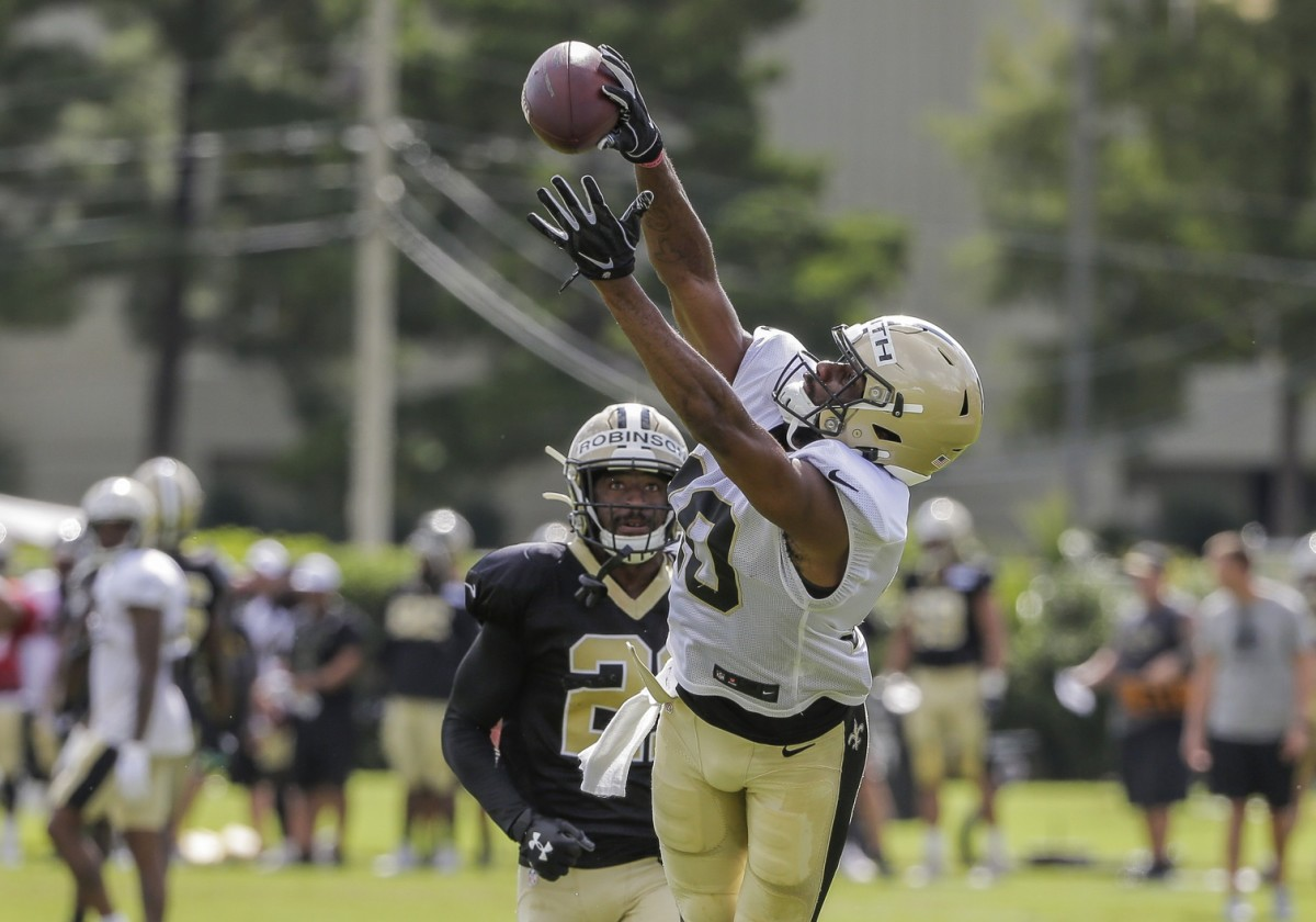 Jul 28, 2019; Metairie, LA, USA; New Orleans Saints wide receiver Tre'Quan Smith (10) catches a pass over defensive back Patrick Robinson (21) during training camp at the Ochsner Sports Performance Center. Mandatory Credit: Derick E. Hingle-USA TODAY