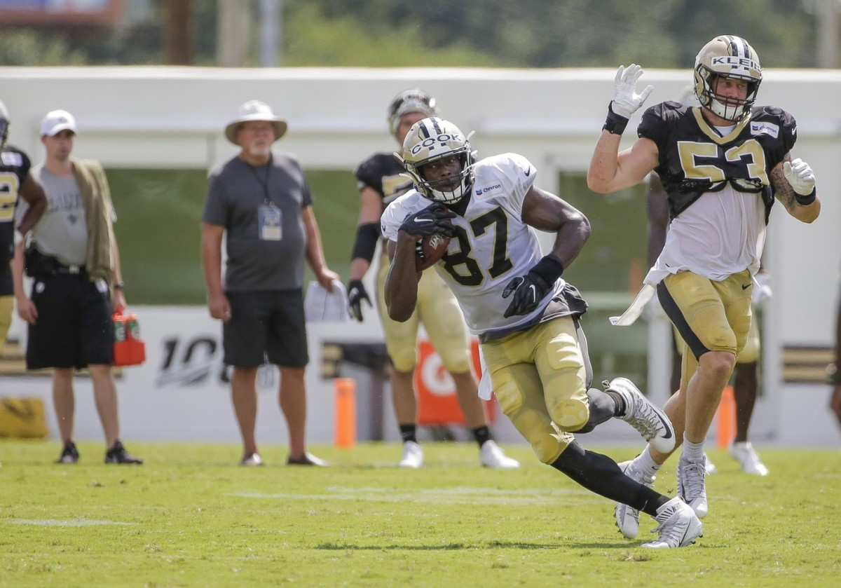 Jul 28, 2019; Metairie, LA, USA; New Orleans Saints tight end Jared Cook (87) runs past outside linebacker A.J. Klein (53) during training camp at the Ochsner Sports Performance Center. Mandatory Credit: Derick E. Hingle-USA TODAY Sports