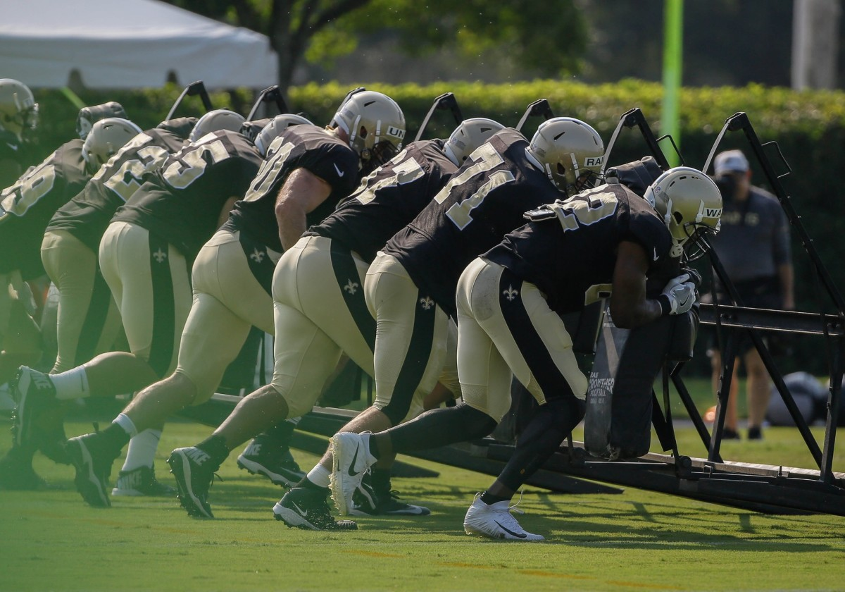 Jul 28, 2018; Metairie, LA, USA; New Orleans Saints offensive line runs a sled drill during training camp at New Orleans Saints Training Facility. Mandatory Credit: Derick E. Hingle-USA TODAY