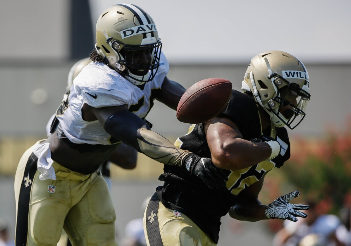 Jul 28, 2018; Metairie, LA, USA; New Orleans Saints linebacker Demario Davis (56) forces a fumble by running back Jonathan Williams (32) during training camp at New Orleans Saints Training Facility. Mandatory Credit: Derick E. Hingle-USA TODAY
