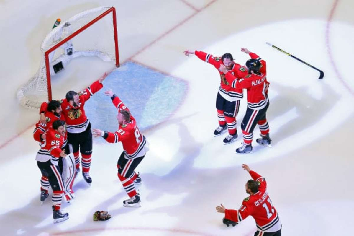 Blackhawks on ice celebrate Bruce Bennett