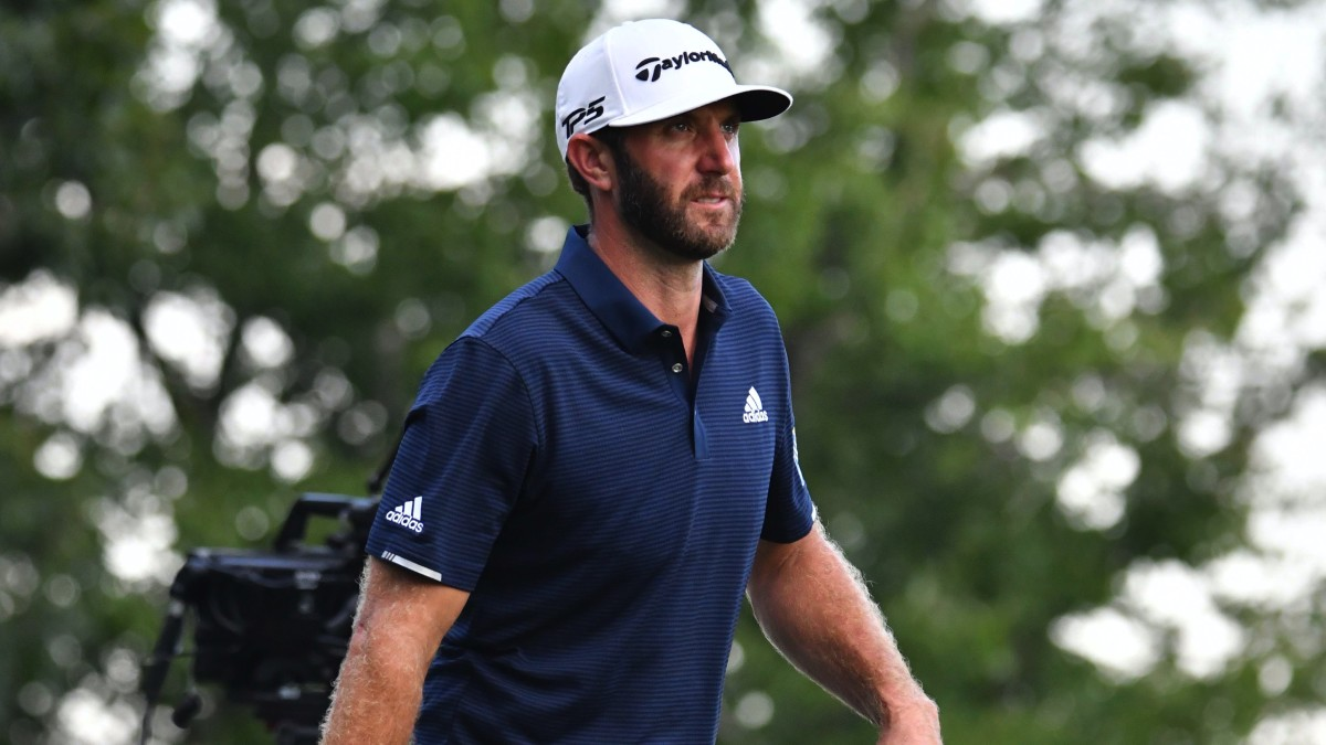 Dustin Johnson walks off the 17th tee during the final round of The Northern Trust golf tournament at TPC of Boston.