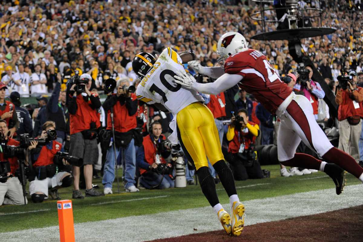 Steelers wide receiver Santonio Holmes catches a touchdown pass as Cardinals safety Aaron Francisco defends during the fourth quarter of the NFL Super Bowl XLIII football game, Feb. 1, 2009, in Tampa, Fla.