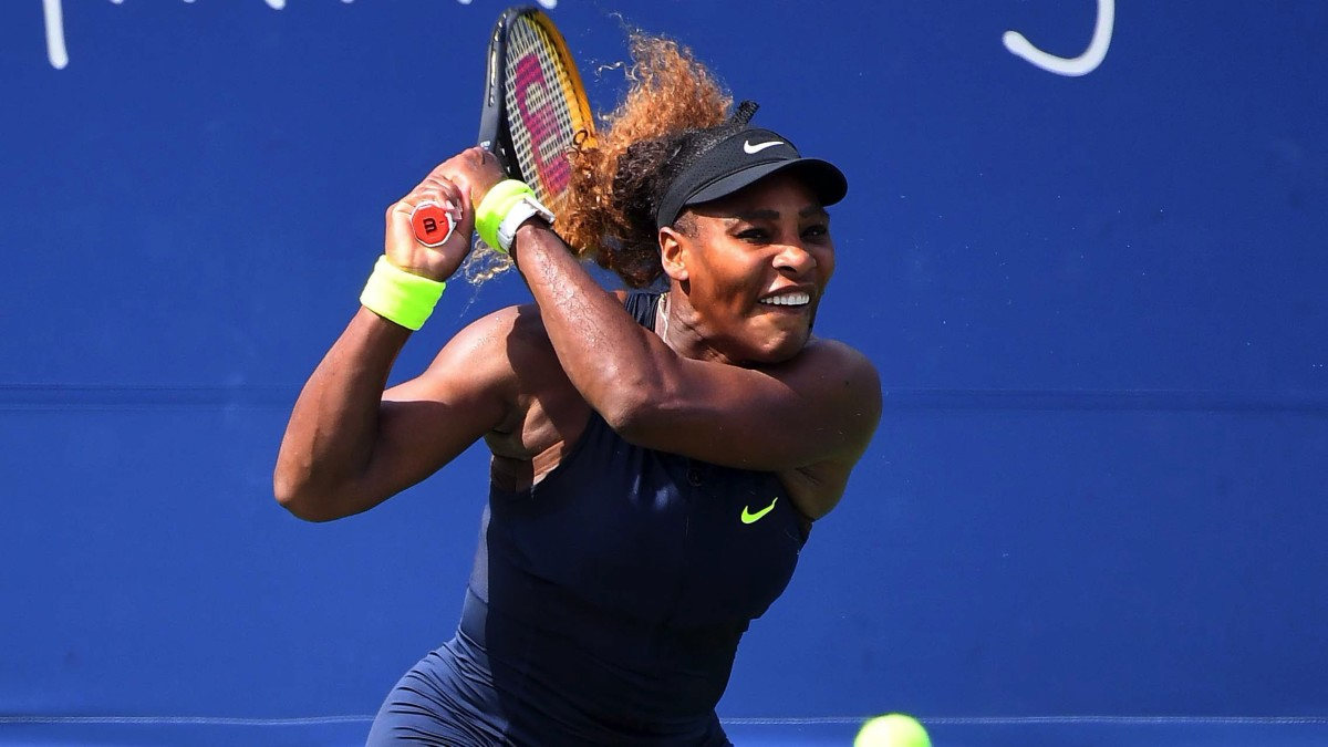 Serena Williams (USA) returns the ball against Arantxa Rus (NED) during the Western & Southern Open at the USTA Billie Jean King National Tennis Center.