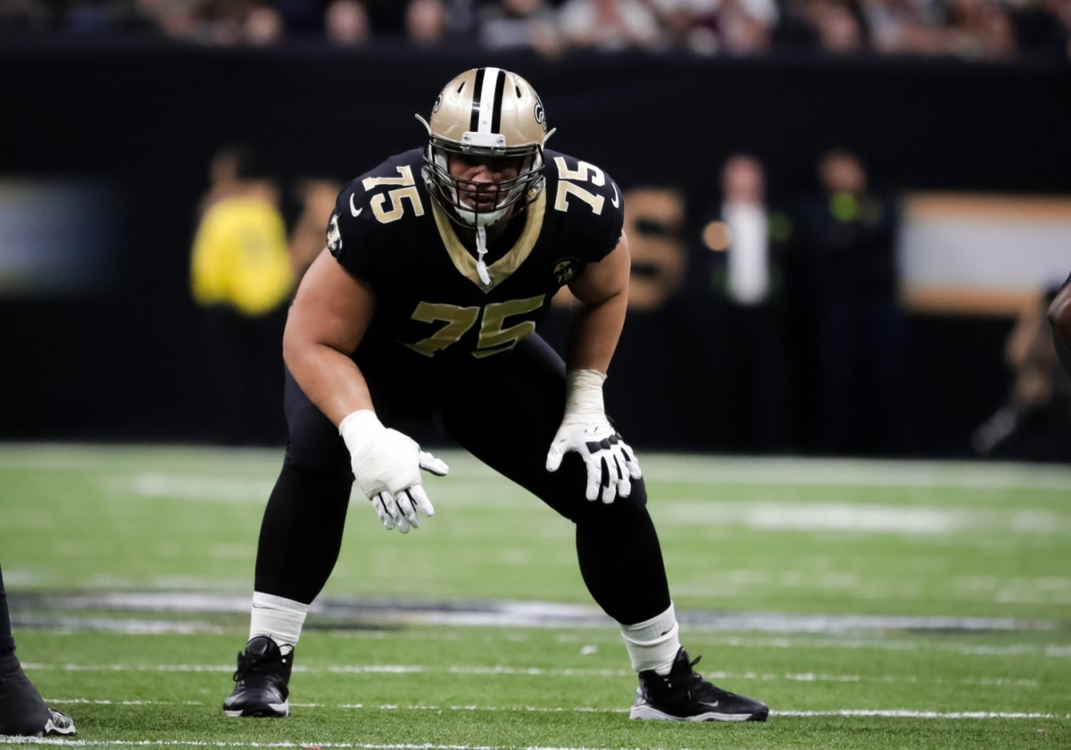 Jan 13, 2019; New Orleans, LA, USA; New Orleans Saints offensive guard Andrus Peat (75) lines up against the Philadelphia Eagles during the third quarter of a NFC Divisional playoff football game at Mercedes-Benz Superdome. Mandatory Credit: Derick E. Hingle-USA TODAY