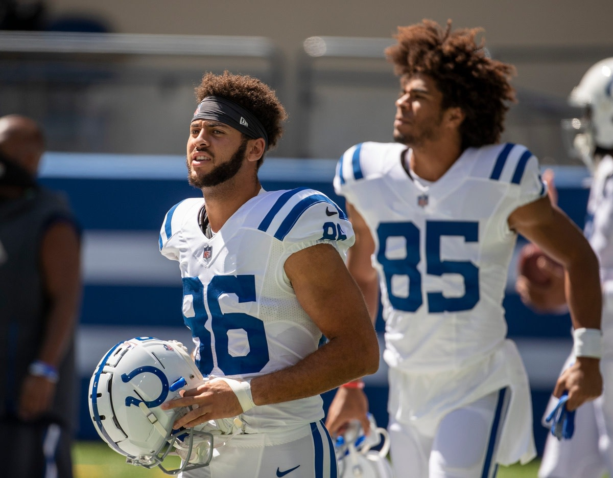 Indianapolis Colts rookie wide receivers Michael Pittman Jr. (86) and Dezmon Patmon (85) prepare for Monday's camp practice at Lucas Oil Stadium.