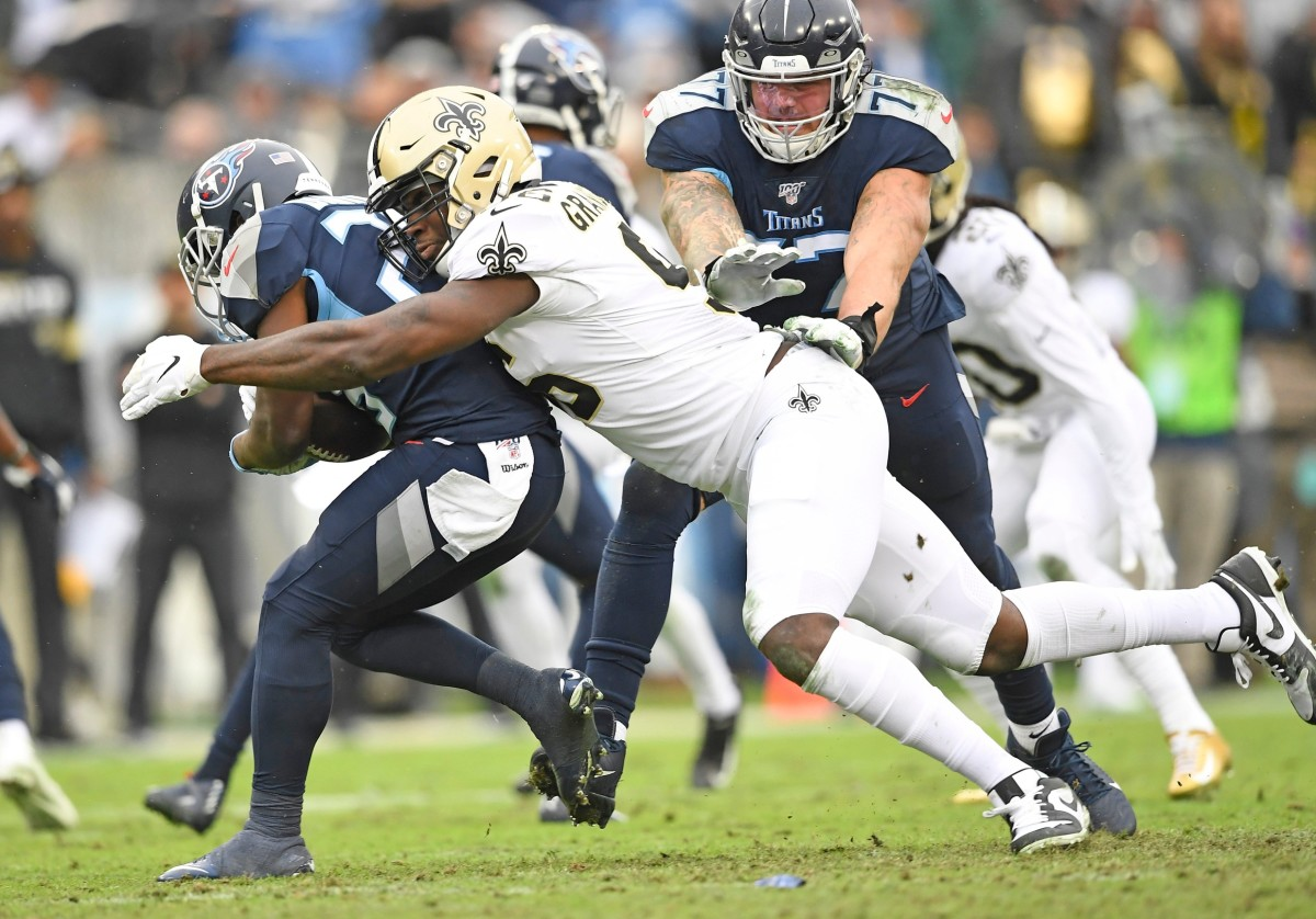 New Orleans Saints defensive end Carl Granderson (96) stops Tennessee Titans running back Dalyn Dawkins (28) during the second quarter at Nissan Stadium Sunday, Dec. 22, 2019 in Nashville, Tenn.