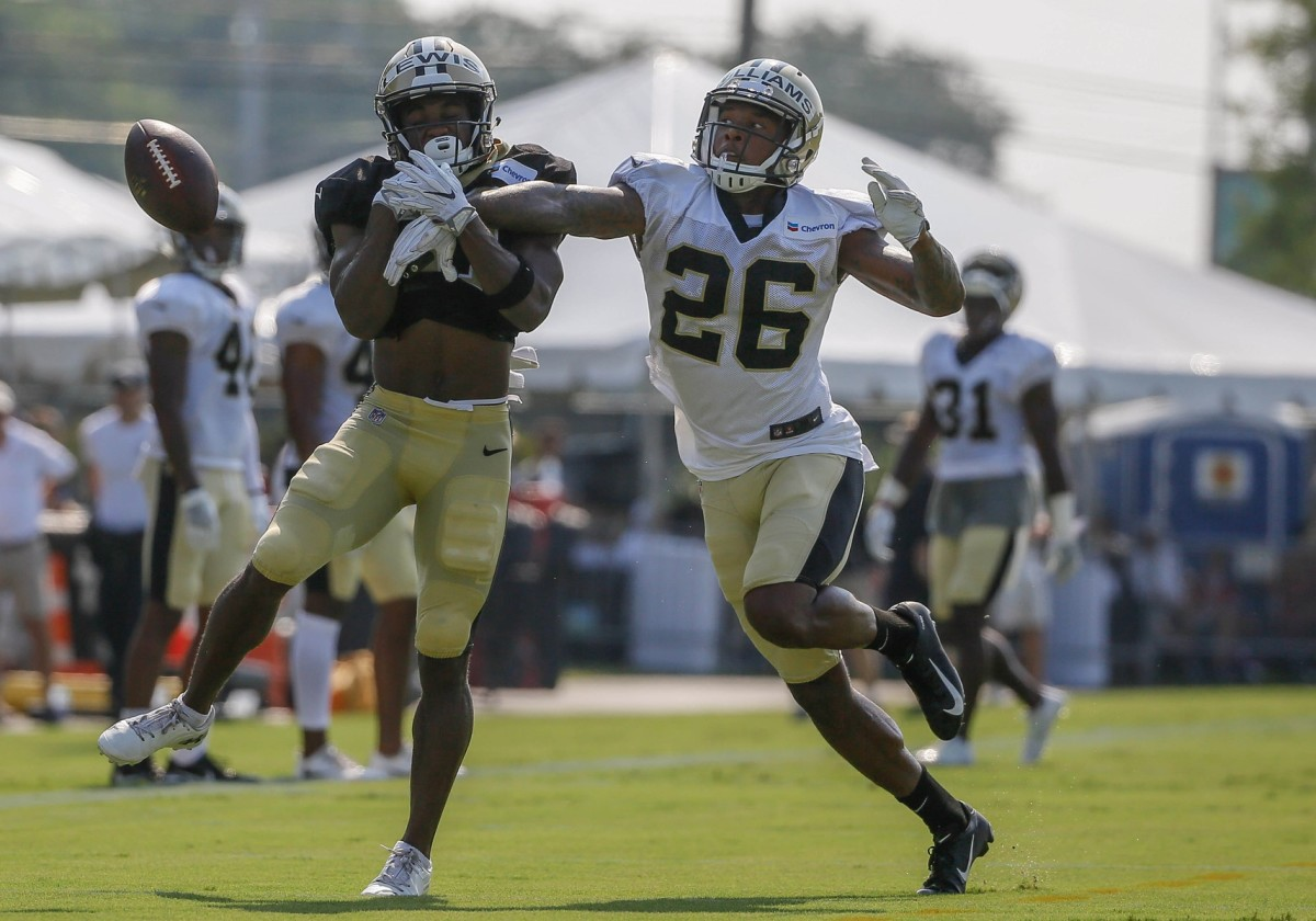 Jul 28, 2018; Metairie, LA, USA; New Orleans Saints cornerback P.J. Williams (26) breaks up a pass to New Orleans Saints wide receiver Tommylee Lewis (11) during training camp at New Orleans Saints Training Facility. Mandatory Credit: Derick E. Hingle-USA TODAY