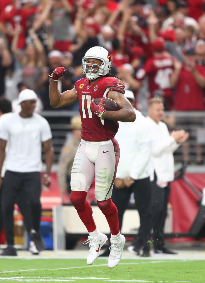 Wide receiver Larry Fitzgerald celebrates after making a catch in the fourth quarter during a 2019 game against the Lions.