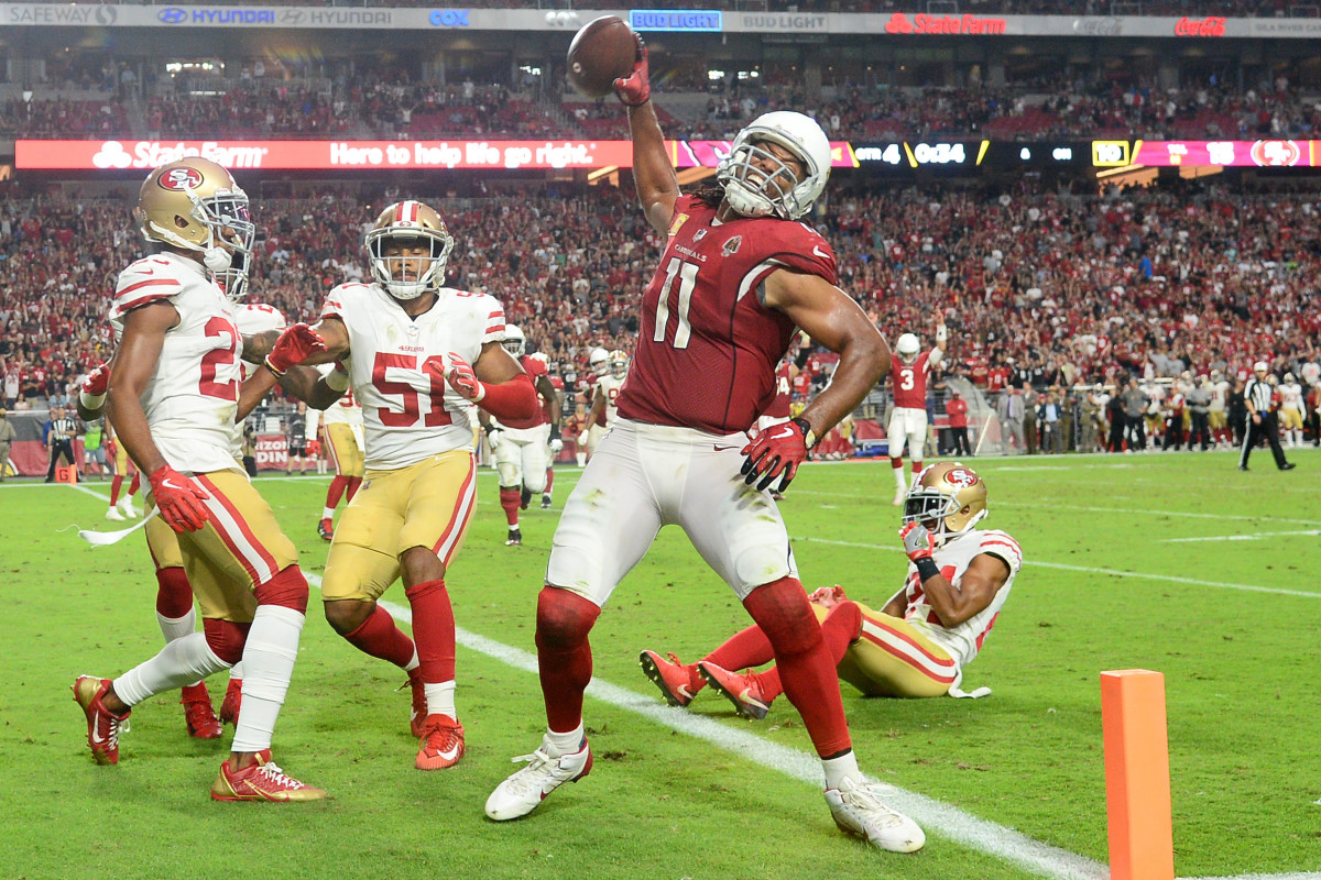 Cardinals wide receiver Larry Fitzgerald spikes the ball after scoring a touchdown against the 49ers during the 2018 season. Fitzgerald has been the face of the franchise for 17 years, but is he the greatest Cardinals player of all time?