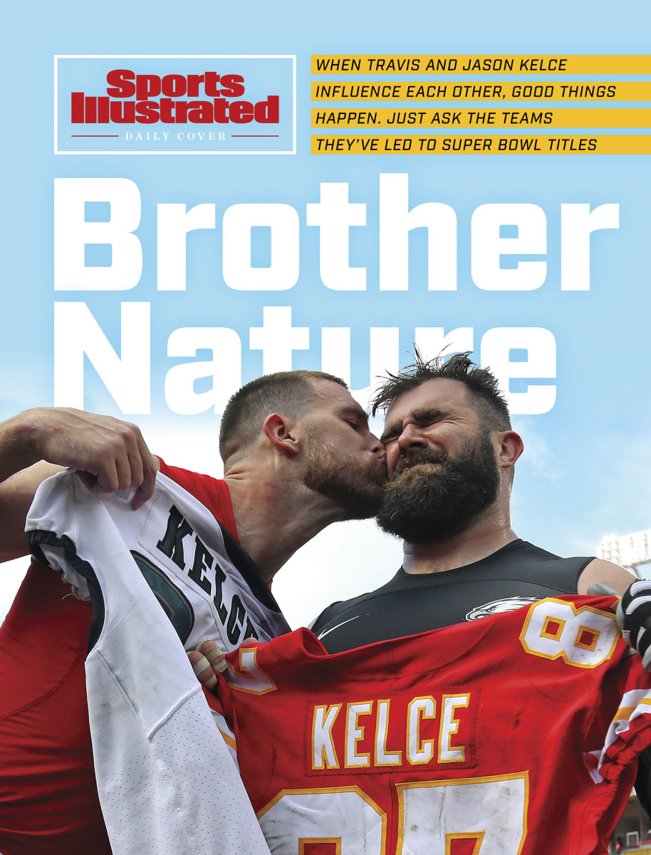 Travis Kelce gives brother Jason a post-game kiss on the cheek as they exchange jerseys