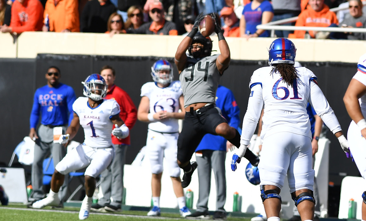 """Ford shows his """"ups"""" going to get an interception against Kansas last season."""