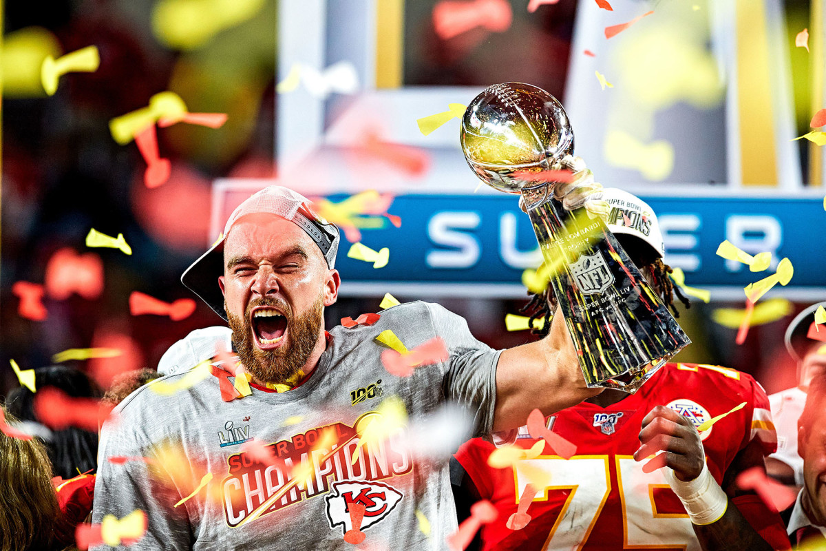 Travis Kelce celebrates with the Lombardi Trophy after Super Bowl LIV