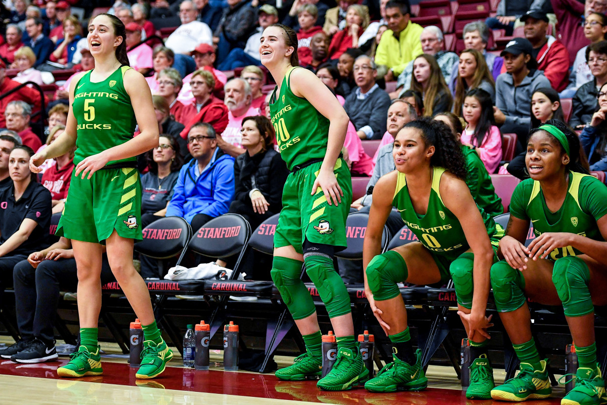 Sabrina Ionescu, Satou Sabally, and two of their Oregon teammates on the bench