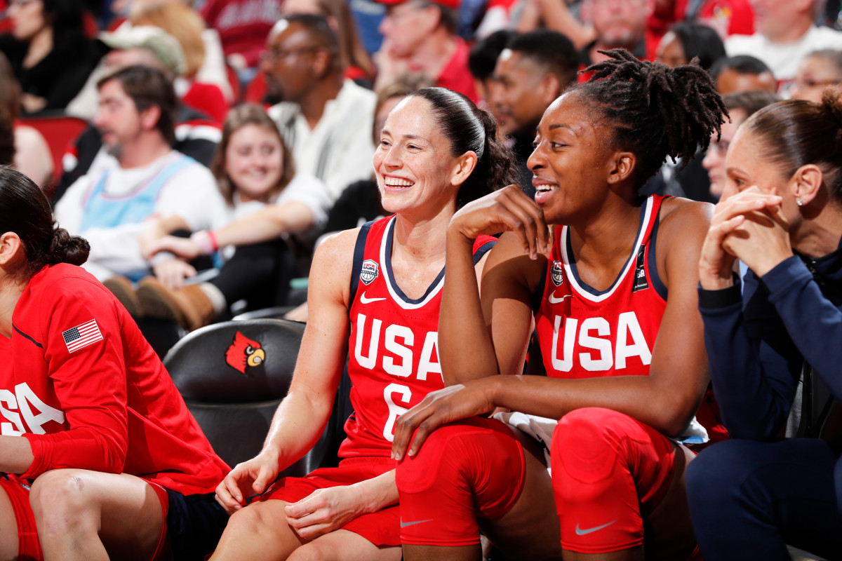 Sue Bird and Nneka Ogwumike smiling in red Team USA jerseys