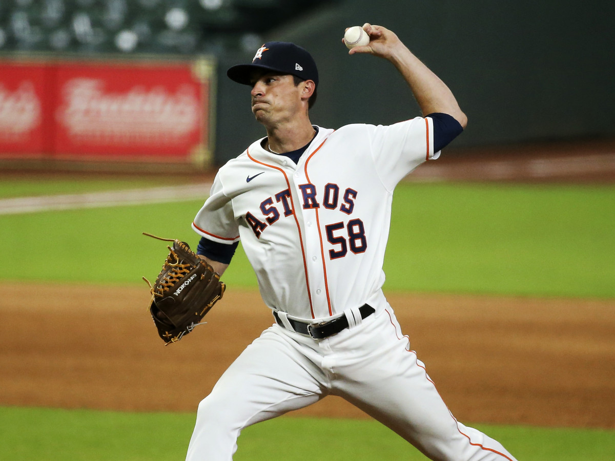Aug 12, 2020; Houston, Texas, USA; Houston Astros relief pitcher Brooks Raley (58) delivers a pitch against the San Francisco Giants during the seventh inning at Minute Maid Park.