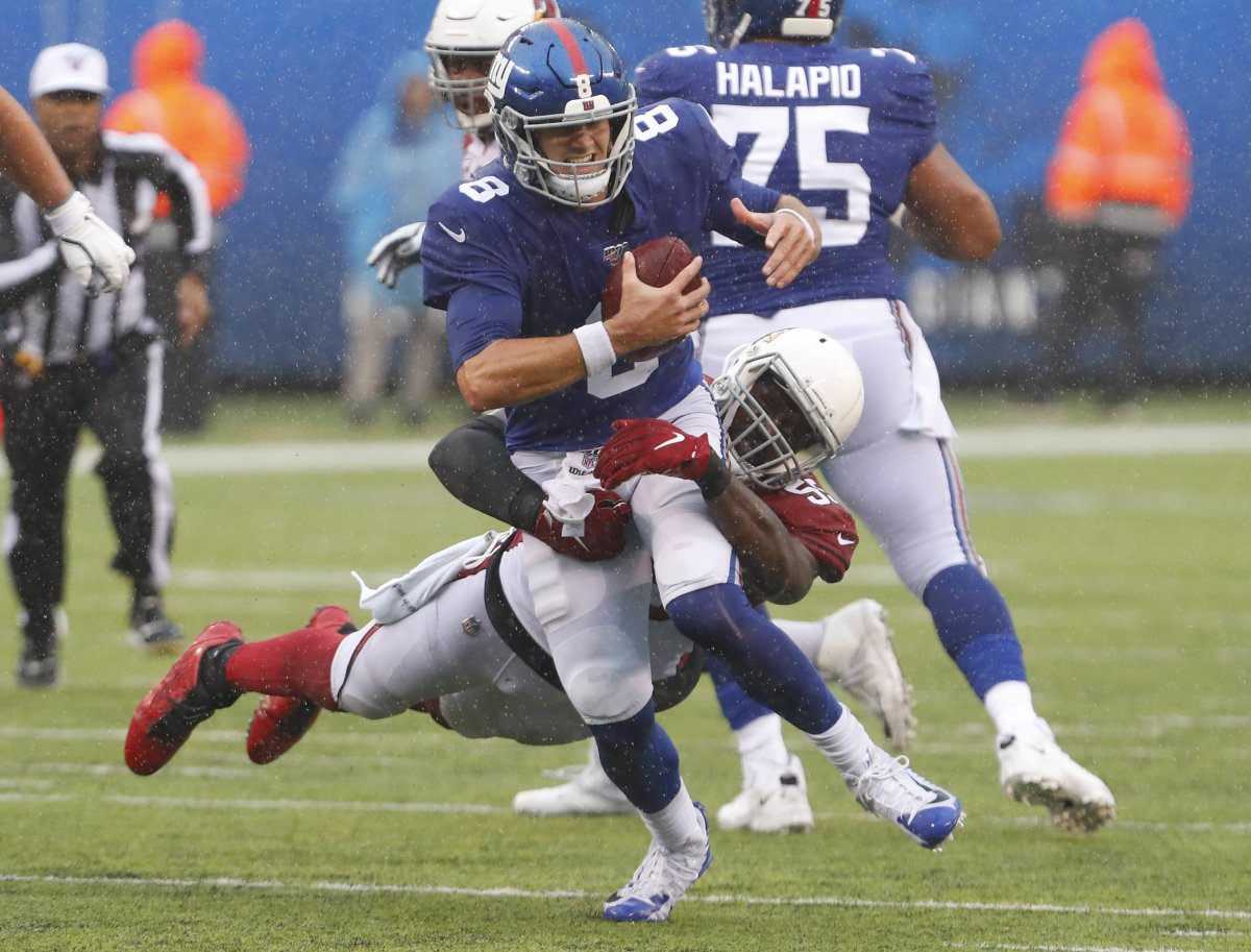 Giants quarterback Daniel Jones (8) is tackled by Cardinals linebacker Chandler Jones (55) during the second half of a 2019 game at MetLife Stadium.