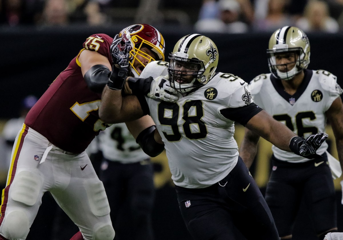 Oct 8, 2018; New Orleans, LA, USA New Orleans Saints defensive tackle Sheldon Rankins (98) rushes against Washington Redskins guard Brandon Scherff (75) during the second half at the Mercedes-Benz Superdome.