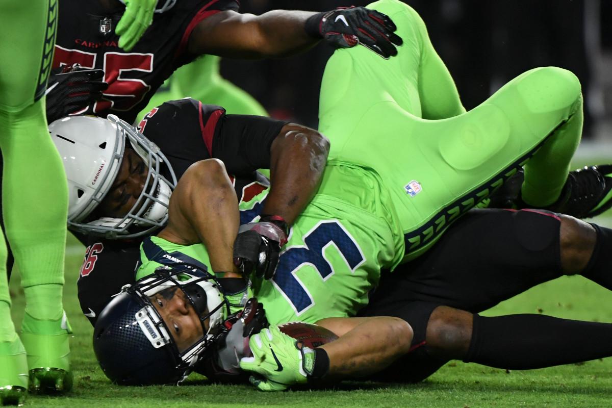 Cardinals linebacker Karlos Dansby (56) tackles Seahawks running back Thomas Rawls (34) during the first half at University of Phoenix Stadium, Nov. 9, 2017.