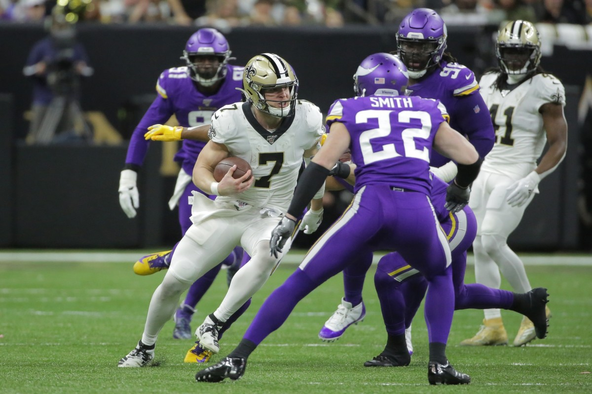Jan 5, 2020; New Orleans, Louisiana, USA; New Orleans Saints quarterback Taysom Hill (7) runs the ball against the Minnesota Vikings during the second quarter of a NFC Wild Card playoff football game at the Mercedes-Benz Superdome. Mandatory Credit: Derick Hingle-USA TODAY Sports