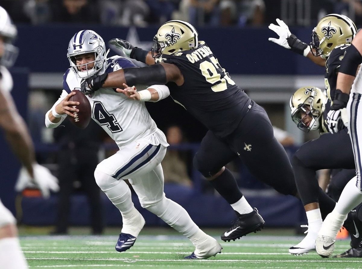 Nov 29, 2018; Arlington, TX, USA; Dallas Cowboys quarterback Dak Prescott (4) is sacked in the first quarter by New Orleans Saints defensive tackle David Onyemata (93) at AT&T Stadium. Mandatory Credit: Matthew Emmons-USA TODAY