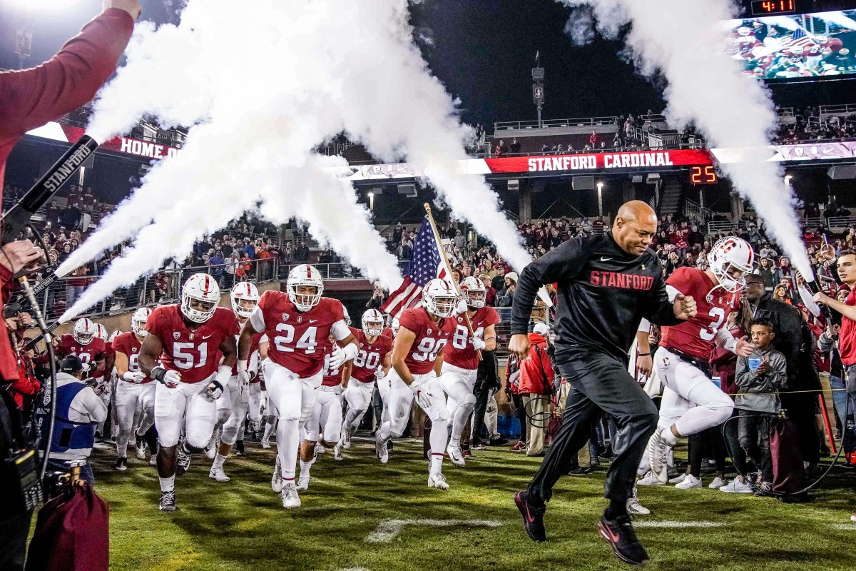 Stanford coach David Shaw runs out with his team