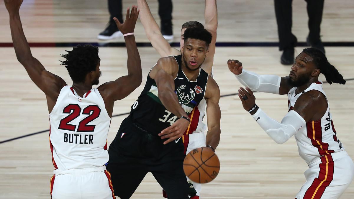 Milwaukee Bucks forward Giannis Antetokounmpo passes the ball against Miami Heat forward Jimmy Butler.