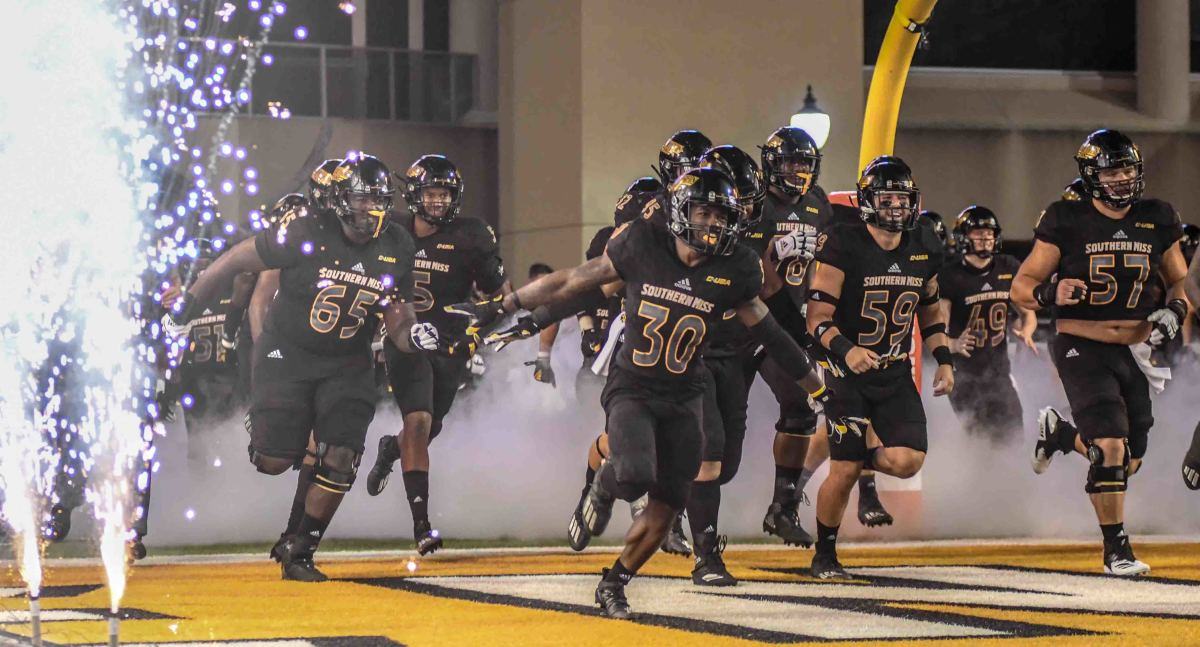 The Southern Miss Golden Eagles run onto the field at M.M. Roberts Stadium for their game against the South Alabama Jaguars in Hattiesburg, Miss., Thursday, Sept. 3, 2020.