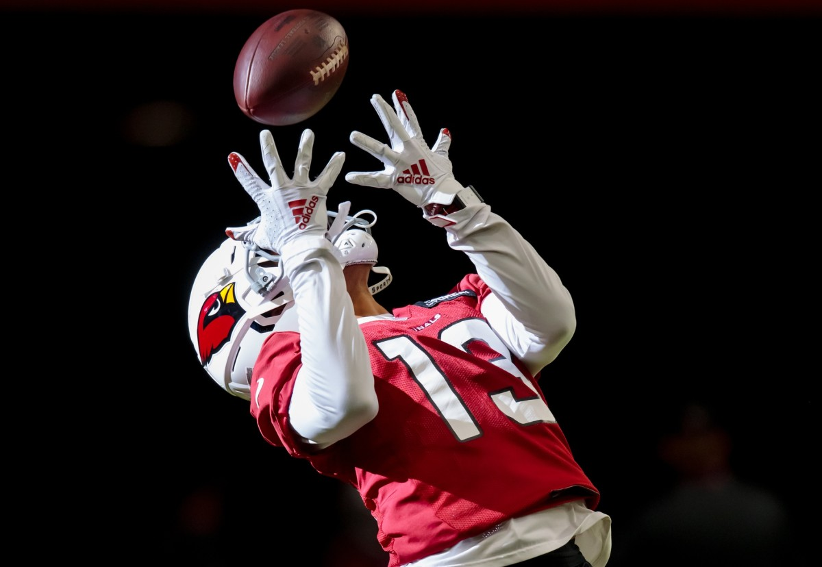 Arizona Cardinals wide receiver Christian Kirk (13) catches a pass during training camp at State Farm Stadium.