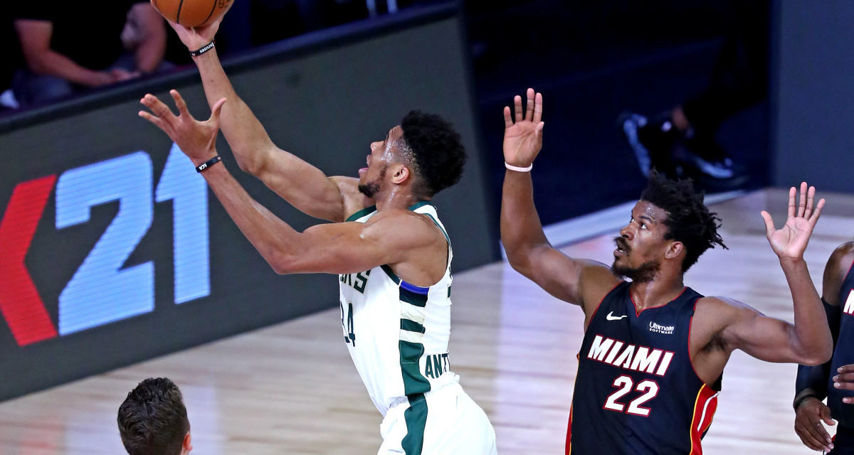 Milwaukee Bucks forward Giannis Antetokounmpo (34) shoots the ball against Miami Heat forward Jimmy Butler (22)