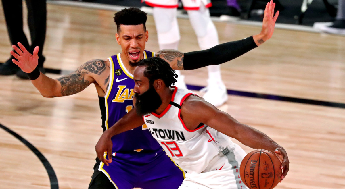 Houston Rockets guard James Harden (13) drives to the basket against Los Angeles Lakers guard Danny Green (14) during the fourth quarter in game one of the second round of the 2020 NBA Playoffs