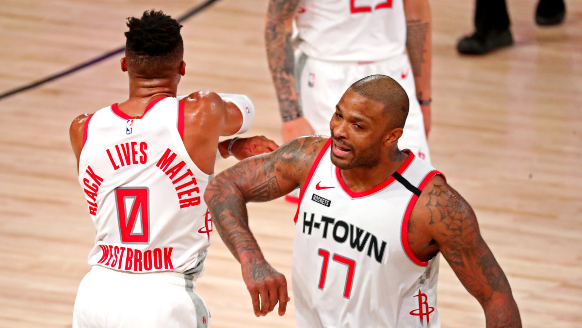 Houston Rockets guard Russell Westbrook (0) celebrates with Houston Rockets forward P.J. Tucker (17) during the fourth quarter against the Los Angeles Lakers