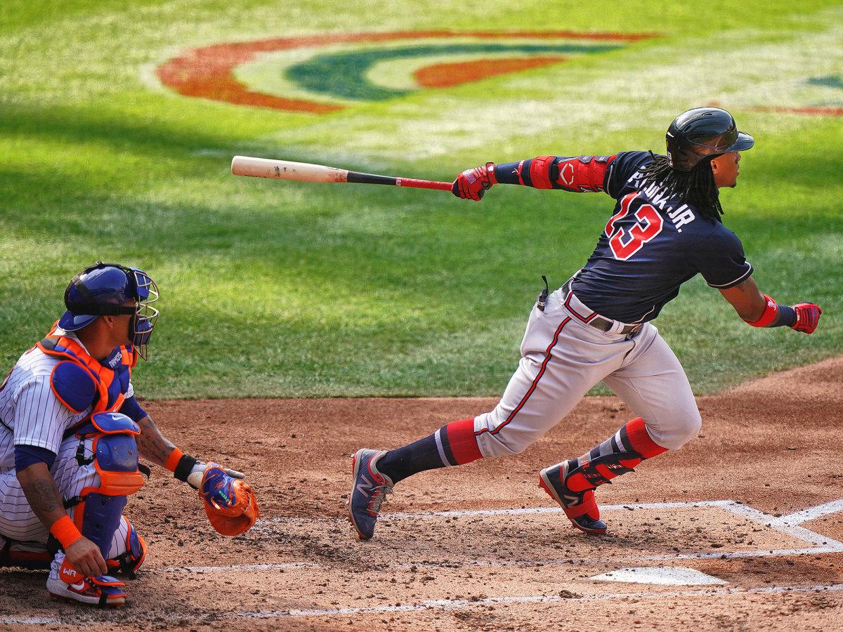 Ronald Acuña Jr. swings a bat