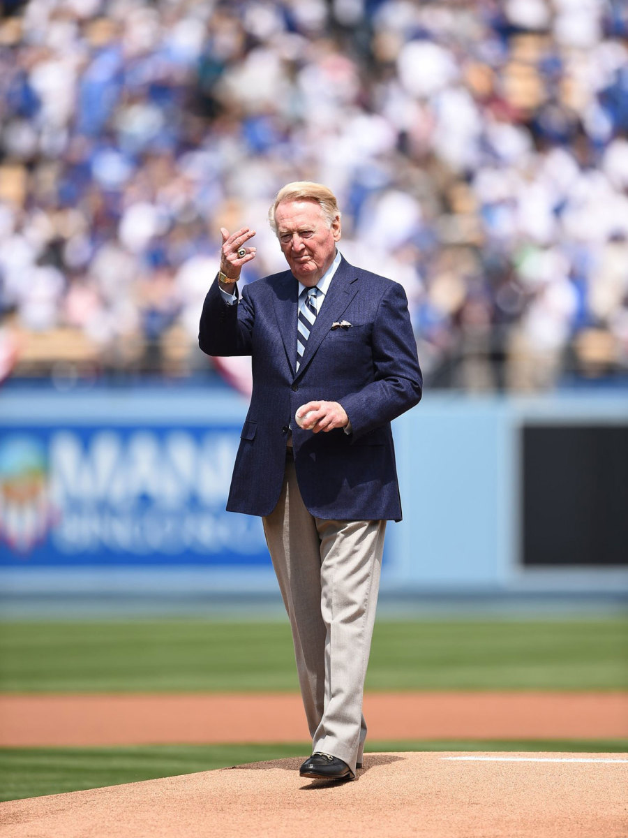 Vin Scully stands on the mound