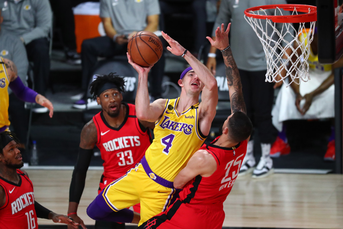 Houston Rockets guard Austin Rivers (25) fouls Los Angeles Lakers guard Alex Caruso (4) in the first half in game four of the second round of the 2020 NBA Playoffs at AdventHealth Arena.